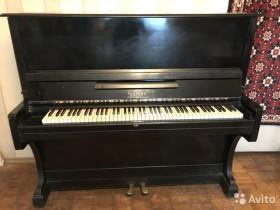 Утилизация пианино.